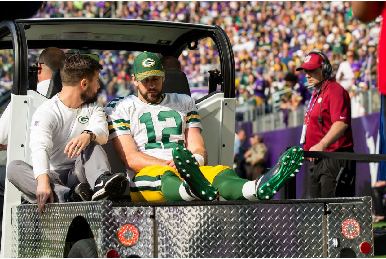Rodgers being carted off due to broken collarbone (Brad Rempel-USA TODAY Sports)