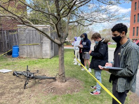 Students in Mr. Aguiars Forensic Science class take notes on a mock crime scene.